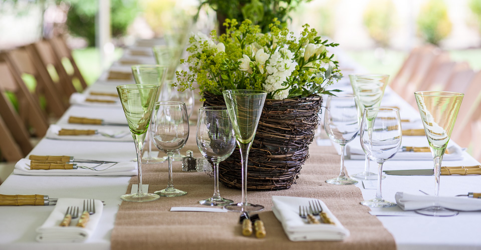 dining place setting with green wine glasses